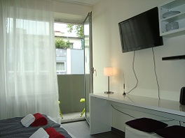 Small Apartment / Ensuit, view B (table and TV set)